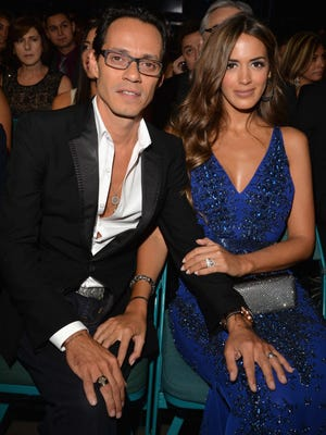 Recording artist Marc Anthony (L) and model Shannon De Lima attend the 15th annual Latin GRAMMY Awards at the MGM Grand Garden Arena on Nov. 20, 2014 in Las Vegas, Nevada.