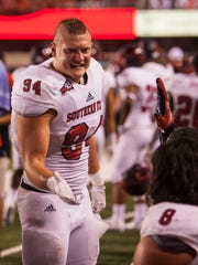 Southern Utah linebacker Taylor Nelson (94) talks with