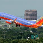 In this May 15, 2014 photo, a Southwest Airlines Boeing 737-700 takes off from Tampa International Airport in Tampa, Fla. Southwest Airlines reports quarterly financial results on Thursday, Oct. 23, 2014. (AP Photo/Chris O'Meara)  ORG XMIT: NYBZ189