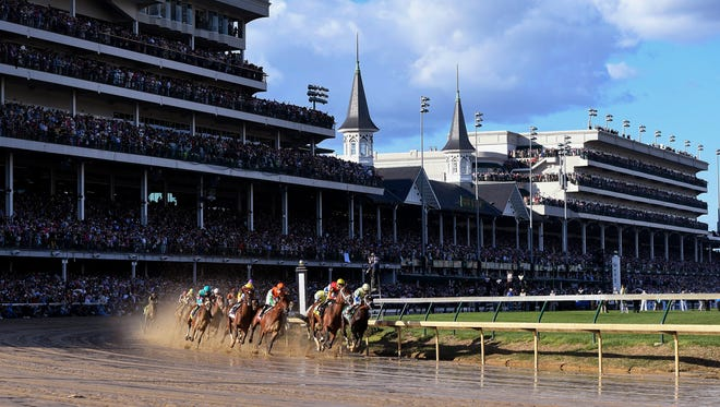 Always Dreaming with John Velaquez aboard (far right on the rail) leads the field around the first turn of the 143rd running of the Kentucky Derby at Churchill Downs. (Photo by David Lee Hartlage, Special to The Courier-Journal) May 6, 2017