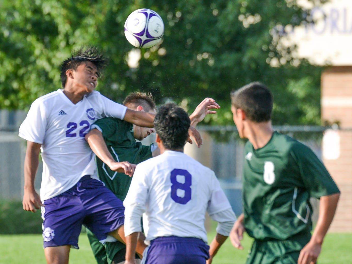 Lakeview's Shem Thang heads the ball to keep it in play Wednesday night as the Spartans face off against the Pennfield Panthers.