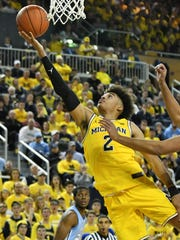 Jordan Poole and Michigan are dropped three spots to No. 5 in this week's Associated Press Top 25 poll.