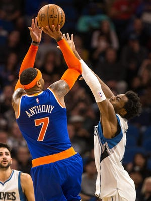 New York Knicks forward Carmelo Anthony shoots over Minnesota Timberwolves forward Andrew Wiggins during the third quarter at Target Center Wednesday night. The Knicks defeated the Timberwolves 106-104.