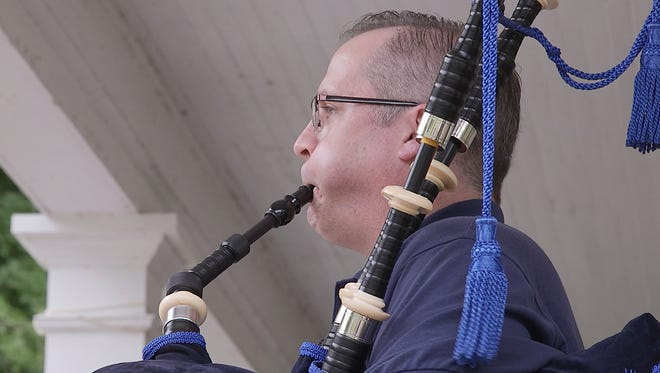 Matt Weasner, Brighton, plays his bagpipes on his lunch break at Webster Park. He's been asked by the police to stop practicing his bagpipes in his yard since a complaint was made by a neighbor.