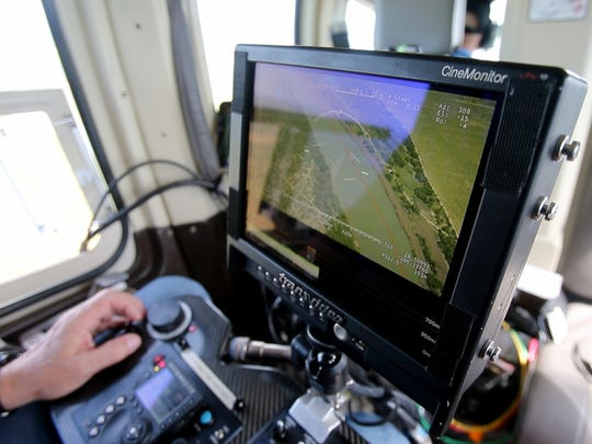 Ron Chapple of Aerial Filmworks operates the helicopter camera as the team flies over the Rio Grande in Texas.