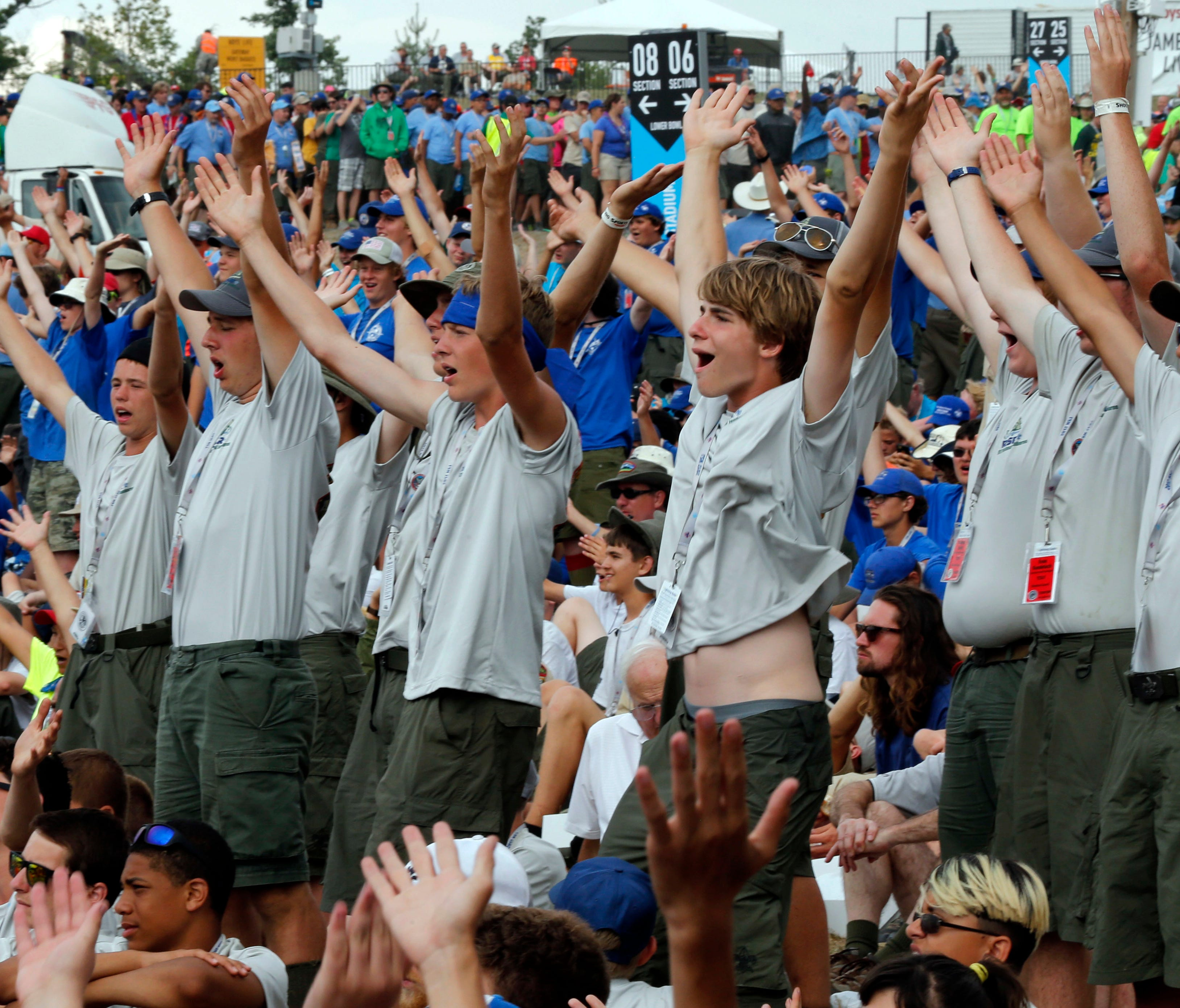 Boy Scouts sing and dance to music as they await the arrival of President Donald Trump at the 2017 National Boy Scout Jamboree at the Summit in Glen Jean, W.Va., Monday, July 24, 2017.