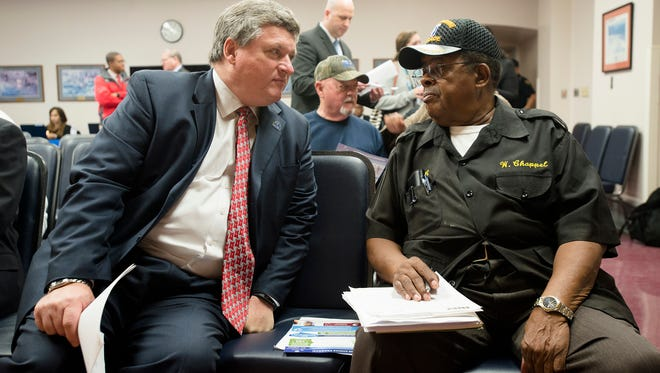 Willis Chappell, disabled American Veteran, right, speaks to Paul Bockelman, CAVHCS interim director, before a Veterans Affairs Town Hall meeting at the VA Hospital on Perry Hill Road in Montgomery, Ala.