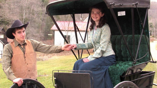 """Jay Bradley stars as Curly and Megan Hull is Laurey in the Maine-Endwell High School production of """"Oklahoma."""""""