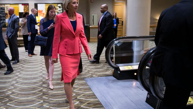 Betsy DeVos, U.S. Secretary of Education, heads toward a reception on the evening she is due to speak at the American Federation for Children's conference, Westin Hotel, Indianapolis, Monday, May 22, 2017.