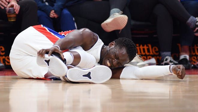 Pistons guard Reggie Jackson (1) reacts after being injured during the third quarter of the Pistons' 107-83 win over the Pacers on Tuesday, Dec. 26, 2017, at Little Caesars Arena.