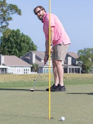 Marc Bradford reacts as his putt just misses on the