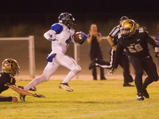 """Cathedral City High School's Timothy Miller Jr. runs for a touchdown against Xavier Prep""""s on September 29, 2017,"""