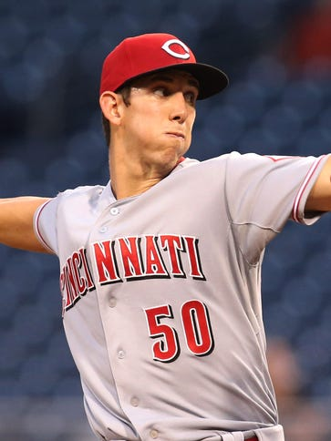 Reds starting pitcher Michael Lorenzen delivers a pitch