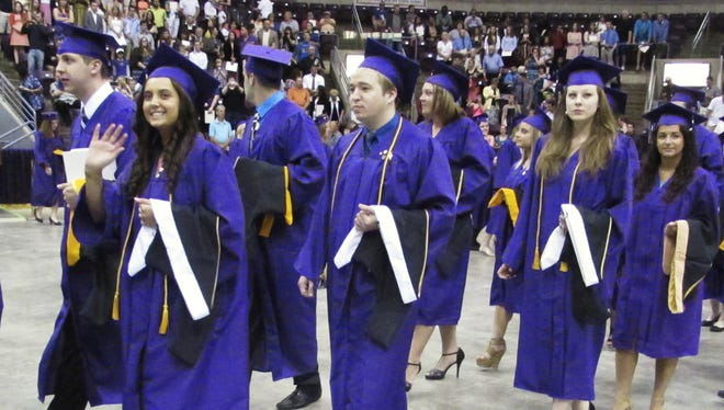 Graduating Elmira College students enter First Arena in Elmira for the 2014 commencement ceremony.