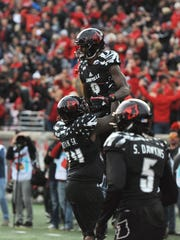 Lamar Jackson celebrates after a touchdown Saturday against Virginia.