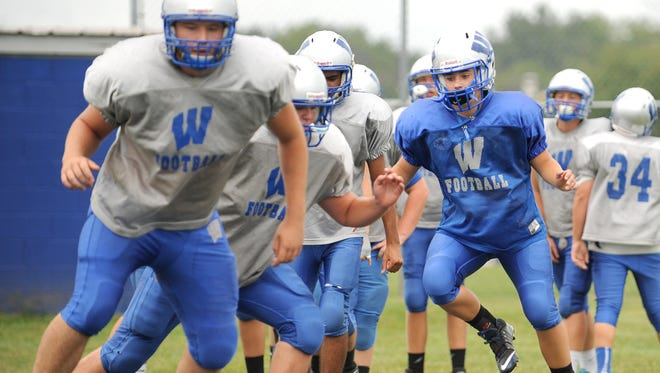 Sierra Richardson runs through drills during a Wynford football practice Wednesday afternoon. Richardson has been playing football for six years.