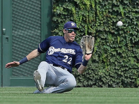 Christian Yelich makes a sliding catch in the seventh inning.