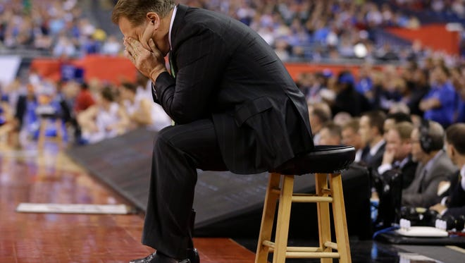 Michigan State head coach Tom Izzo looks down during the second half of the NCAA Final Four tournament college basketball semifinal game against Duke Saturday, April 4, 2015, in Indianapolis.