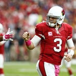 Cardinals quarterback Carson Palmer greets Michael Floyd after a 20-yard touchdown pass against Washington Redskins in the first half on Oct. 12, 2014 at University of Phoenix Stadium in Glendale.