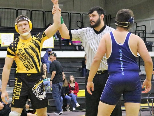 Alamogordo's Devin Brown, left, celebrates a victory