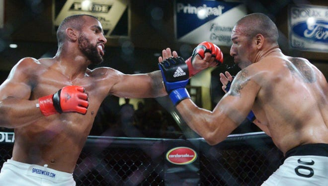 Devin Clark of Sioux Falls throws a punch at Dervin Lopez of Tampa, Florida, in a RFA 29, Resurrection Fighting Alliance fight Friday night at the Sanford Pentagon, Aug 21, 2015.