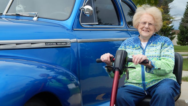 Resident Doris Miller took the opportunity to examine the craftsmanship of a classic car at a classic car show hosted by Sanctuary at Mercy Village for residents and family members. Despite the chilly weather, everyone enjoyed viewing the cars of the Country Cruisers Classic Car Club.