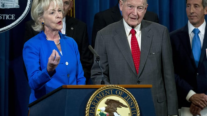 Lynda Webster and her husband, former FBI director and the CIA director William Webster, who were targeted by a man who peddled a lottery scam over phone calls and emails, speaks during a news conference to address elder financial exploitation and law enforcement actions, at Department of Justice in Washington, March 7, 2019.