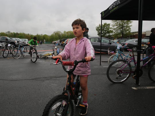 Doree Lipson, 5. stops for a moment atop her new bike.