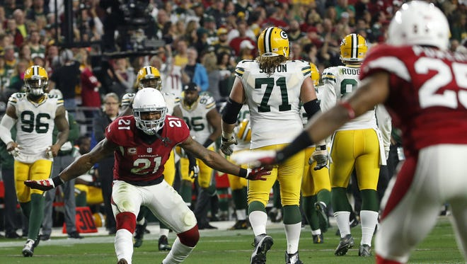 Arizona Cardinals CB Patrick Peterson (21) celebrates a touchdown by CB Jerraud Powers against Green Bay Packers during the third quarter in NFL action December 27, 2015 in Glendale, Ariz.