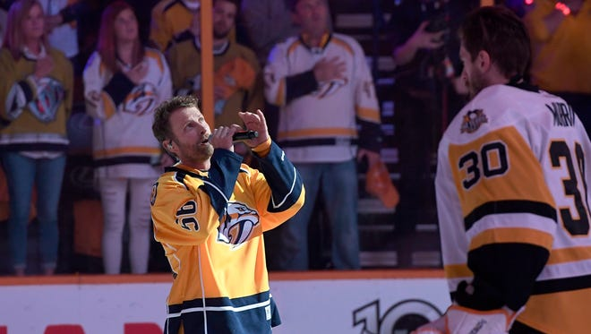Dierks Bentley sings the National Anthem before Game 4 in the Stanley Cup Final at Bridgestone Arena Monday, June 5, 2017, in Nashville, Tenn.