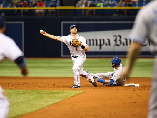 Toronto Blue Jays' Jose Bautista (19) interferes with Tampa Bay Rays second baseman Logan Forsythe as he looks to turn a double play on a ball hit by Edwin Encarnacion, that ended the baseball game after review, in St. Petersburg, Fla., on Tuesday, April 5, 2016. The Rays won 3-2. (Will Vragovic/The Tampa Bay Times via AP)
