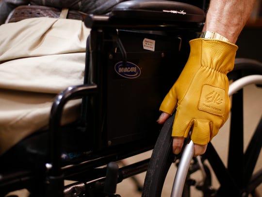 Robert Hicklin, a U.S. Navy veteran, wears his fingerless