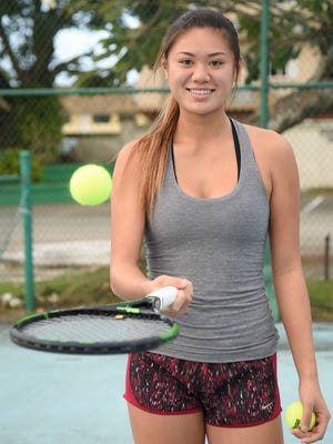 Guam native Nadine Del Carmen, tennis standout at Weil Tennis Academy in California, gets ready for hitting practice in Tamuning on Dec. 22, 2016.