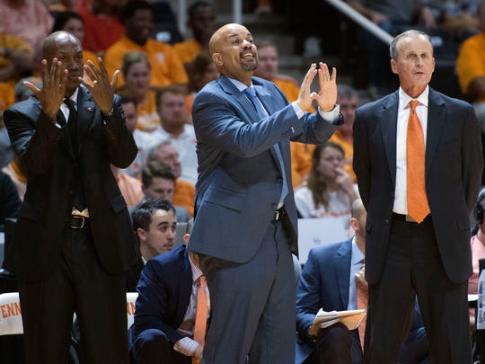 Tennessee assistant coaches Rob Lanier, center, and Desmond Oliver give instructions to their players during the game against Florida last season. At right is head coach Rick Barnes.