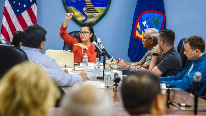 Chamorro Land Trust Commission Chairwoman Pika Fejeran, makes reference to the sequential and chronological order of Chamorro Land Trust By-passed applications submitted and processed, since 1995, especially regarding land trust lots currently under scrutiny in the area of Barrigada Heights, during a commission meeting on Thursday, May 17, 2018.