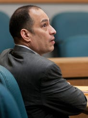 Former El Paso County Judge Anthony Cobos looks up