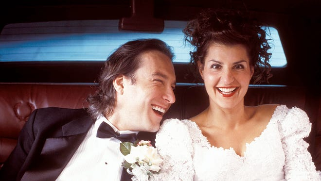 """John Corbett, left, and Nia Varadalos in a scene from the motion picture """"My Big Fat Greek Wedding."""""""