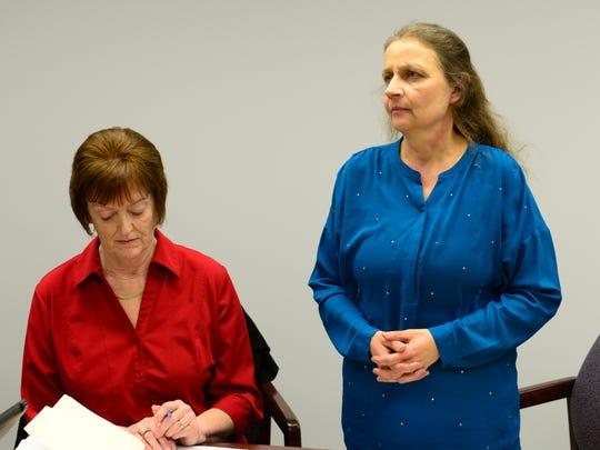 New clyde school board member Trisha Prunty, right, is sworn in on Wednesday evening, next to Nancy Greenslade.