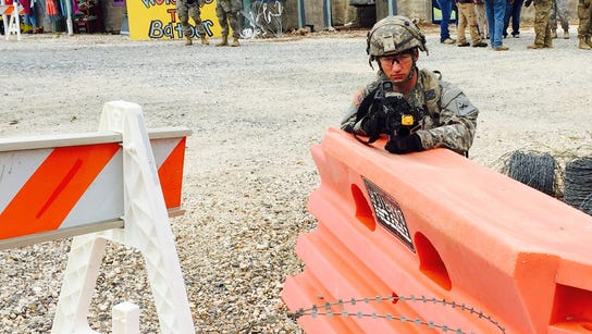 4) Pvt. Tyler Williams, of Lebanon, Ohio, pulls security
