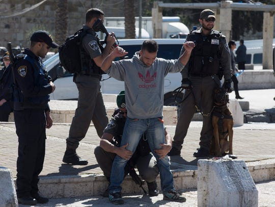 Israeli anti-riot police conduct a routine check on