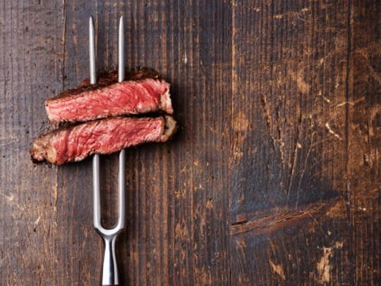 A BBQ fork is perfect for use when slicing and plating,