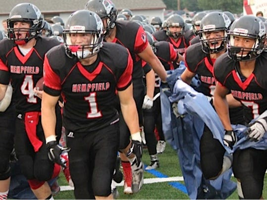 Hempfield runs onto the field prior to their game against Lampeter-Strasburg on Friday, September 4, 2015.