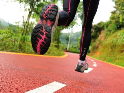 healthy lifestyle fitness sports woman legs running at park trail
