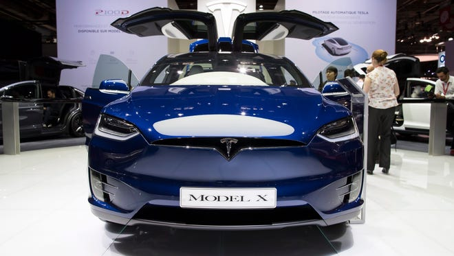 A Tesla Model X is displayed at the Paris Motor Show in Paris on Sept. 30, 2016. The base model has a 237 mile range and starts at $79,500, according to Tesla.