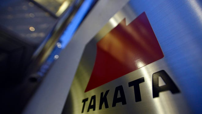 The logo of Japanese auto-parts supplier Takata Corp. at the company  headquarters in Tokyo.