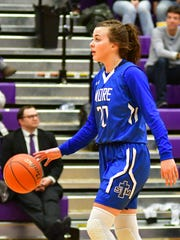 St. Thomas More's Klaire Kirsch dribbles the ball during