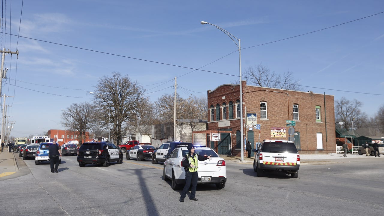 Police create a perimeter on North National Avenue near Atlantic as they investigate an officer-involved shooting.