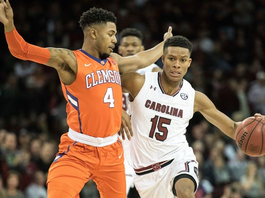 South Carolina guard PJ Dozier (15) drives to the hoop against Clemson guard Shelton Mitchell (4) during the first half of an NCAA college basketball game, Wednesday, Dec. 21, 2016, in Columbia, S.C. (AP Photo/Sean Rayford)