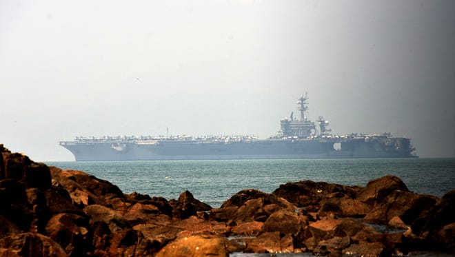 The U.S. aircraft carrier USS Carl Vinson arrives in Da Nang, Vietnam, March 5,  2018.