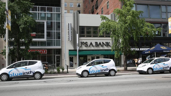 The construction of several new BlueIndy electric car stations in Indianapolis is reducing on-street parking in front of businesses. The BlueIndy charging station at Meridian and Washington streets, shown on Friday, July 10, 2015, is in a no-parking zone in front of (from left) Chipotle, Jos. A. Bank and Georgia Reese's.